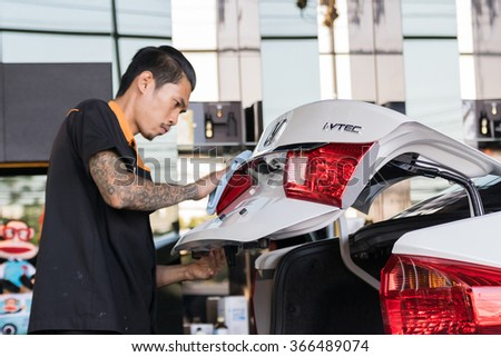 Bangkok, Thailand - December 12, 2015 : Unidentified car care staff cleaning the car.