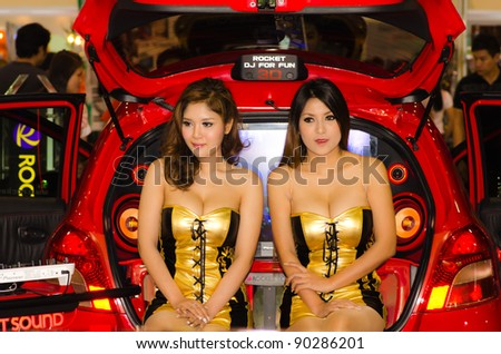 BANGKOK, THAILAND - DECEMBER 6: Unidentified female presenter at Pioneer booth in THE 28th THAILAND INTERNATIONAL MOTOR EXPO 2011 on December 6, 2011 in Bangkok, Thailand. - stock photo