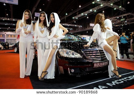 BANGKOK, THAILAND - DECEMBER 3: Unidentified females presenter at brabus booth in the 28th Thailand International Motor Expo 2011 on December 3, 2011 in Nonthaburi, Thailand.
