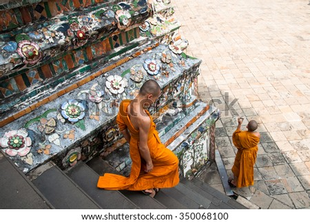 Bangkok, Thailand. December 2012. Unidentified monks visit the Buddhist temple Wat Arun - stock photo