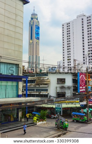 BANGKOK, THAILAND - FEB 20, 2015: In distance you can see the skyscraper hotel,  Baiyoke sky. The building is considered the tallest in Bangkok and has a height of 304 m above the ground - stock photo