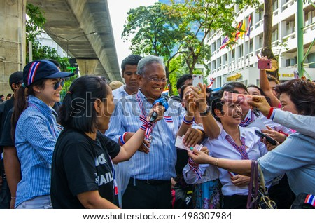 Bangkok, Thailand - FEB 7, 2014: Mr. Suthep Thaugsuban, the PDRC Secretary-General and  Ms. Anchalee Paireerak, the PDRC core-leader during the march in Silom area.