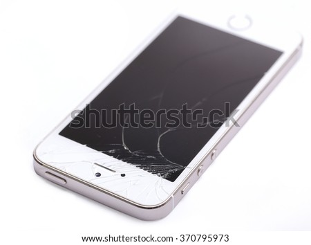 Bangkok, Thailand - Feb 01: Studio shot of an iPhone 5 with seriously broken retina display screen isolated on white on Feb 01, 2015. iPhone 5 is a smartphone developed by Apple Inc.