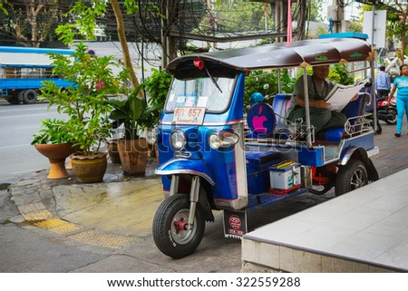 BANGKOK, THAILAND - FEB 20, 2015: Tuktuk in downtown Bangkok, traditional taxis. Tuktuk is popular among tourists - stock photo