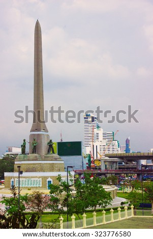 BANGKOK, THAILAND - FEB 20, 2015: Victory Monument - big military monument in Bangkok, Thailand. Monument is one of the most familiar landmarks of Bangkok - stock photo