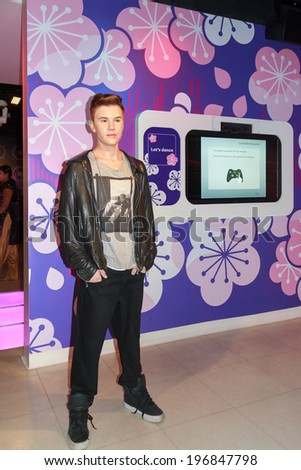 BANGKOK, THAILAND -  FEB. 02, 2014  - Wax figure of Justin Bieber at museum Madame Tussauds in Bangkok, Feb. 02, 2014. - stock photo