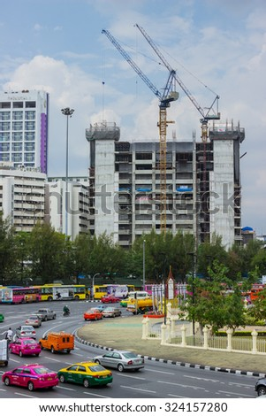 BANGKOK, THAILAND - FEB 20, 2015: We see the construction of high-rise buildings. Bangkok has a population of 8.5 million and continues to grow - stock photo