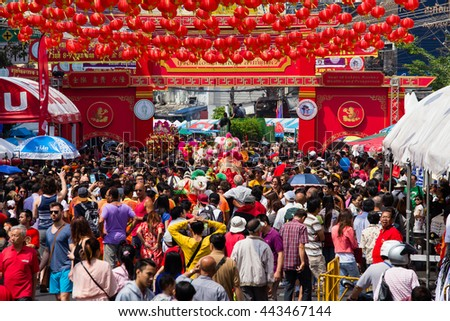 BANGKOK, THAILAND - FEBRUARY 08, 2016 : A crowd of people roams the street of Yaowarat during the celebration of Chinese New Year and Valentine's Day. Yaowarat is a Chinatown situated in Bangkok. - stock photo