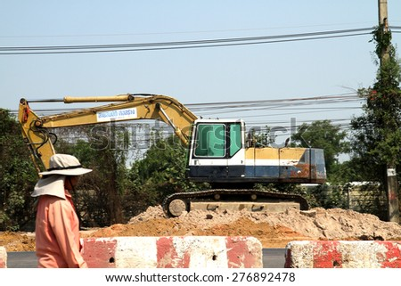 BANGKOK-THAILAND-FEBRUARY 2 : A loader for construction the road on February 2, 2015 Bangkok, Thailand. - stock photo