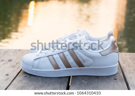 BANGKOK, THAILAND - FEBRUARY 17, 2018 : Adidas Superstar W white/gold shoes