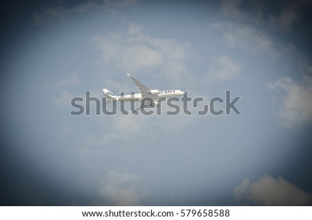 BANGKOK, THAILAND - February 5, 2017 : Passenger air plane flying on blue sky white clouds background