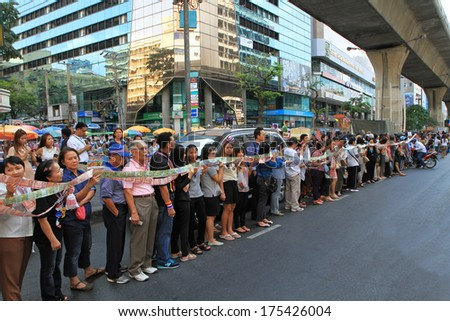 BANGKOK,THAILAND-FEBRUARY 7:Protesters hold cash donations for farmers before give to Suthep Thaugsuban led a procession of protesters in a march through Silom on February 7,2014 in Bangkok,Thailand.  - stock photo