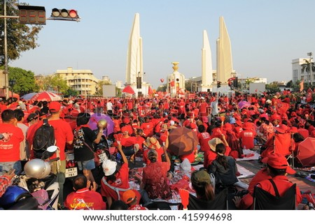 Bangkok, Thailand - February 13, 2011: Protesters take part in a large anti government Red Shirt rally at the landmark Democracy Monument. - stock photo