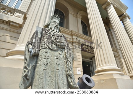 BANGKOK, THAILAND - FEBRUARY 19, 2015: Statue of chinese man at Wat Phra Kaew in Bangkok, Thailand. - stock photo
