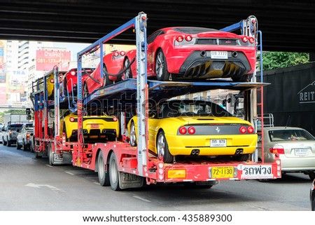 BANGKOK, THAILAND - FEBRUARY 23 : The trailer transports cars are carrying Ferrari cars in Bangkok on FEBRUARY 23, 2015 in Bangkok, Thailand.