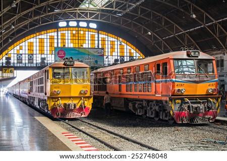 BANGKOK , THAILAND- FEBRUARY 04,2015: Trains waits at a platform of railway station Hua Lamphong in Bangkok. Hua Lamphong opened in 1916 and  serves apprx 70,000 passengers and 150 trains each day. - stock photo
