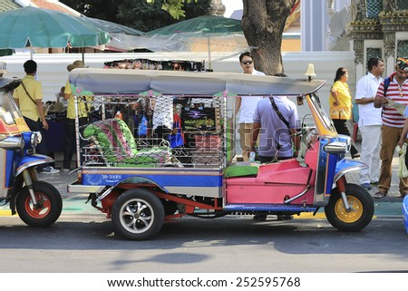 BANGKOK THAILAND  FEBRUARY 4: TUK TUK driver is talking to the passenger in front of Wat Phra Chetuphon or Wat Pho temple on Thai Wang Road on February 4, 2015 in Bangkok, Thailand - stock photo