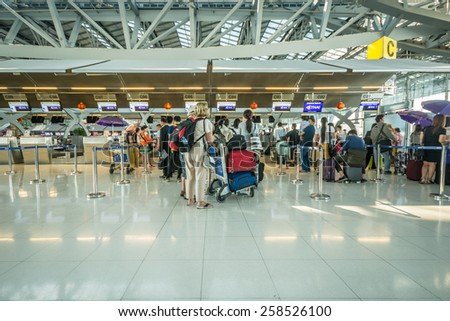 Bangkok,Thailand-February 27,2015:Unidentified passengers arrive at the check-in counters at the Suvarnabhumi Airport in Bangkok, Thailand. The airport handling about 45 million passengers annually.
