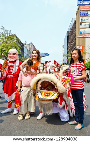 BANGKOK, THAILAND - FEBRUARY 10: Unidentified people celebrate with chinese lion at Yaowarat Road in Chinatown district during the Chinese New Year celebration on February 10, 2013 in Bangkok,Thailand