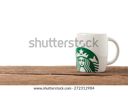 BANGKOK, THAILAND - FEBRUARY 26, 2015: White ceramic cup with Starbucks logo. Starbucks is the world's largest coffee house with over 20,000 stores in 61 countries. - stock photo