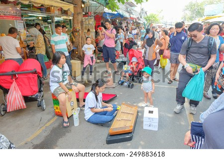 BANGKOK, THAILAND - :1 Febuary Street show of thailand instrument in shopping market on Febuary 1 , 2015 in Bangkok, Thailand. Chatuchak (or Jatujak) weekend market is the largest market in Thailand. - stock photo