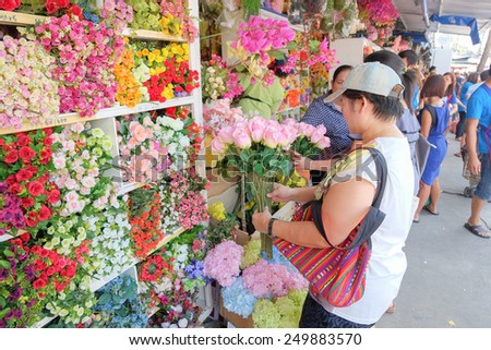 BANGKOK, THAILAND - :1 Febuary Tourists shopping paper flower in shopping market on Febuary 1 , 2015 in Bangkok, Thailand. Chatuchak (or Jatujak) weekend market is the largest market in Thailand. - stock photo