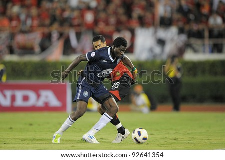 BANGKOK, THAILAND - JAN 11: Bouba Abbo  of the Buriram PEA (L) in action during the Thaicom FA Cup Final match  between MuangThong United at National Stadium of Thailand on Jan11, 2012 in Bangkok Thailand. - stock photo