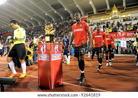 BANGKOK, THAILAND - JAN 11:  Dagno Siaka (R) of the MuangThong United in action during theThaicom FA Cup Final match between and Buriram PEA at National Stadium on January11,2012 in Bangkok Thailand. - stock photo