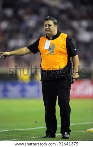 BANGKOK, THAILAND - JAN 11:  Head Coach Milos Josic of the MuangThong United in action during theThaicom FA Cup Final match between and Buriram PEA at National Stadium on January11,2012 in Bangkok Thailand.