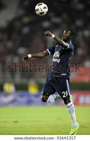 BANGKOK, THAILAND - JAN 11: Obama Joseph Florent of the Buriram PEA in action during the Thaicom FA Cup Final match  between MuangThong United at National Stadium on Jan11,2012 in Bangkok Thailand. - stock photo