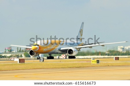 Bangkok - THAILAND , January 9,2016 ; A Boeing 777-200 of NokScoot Airlines Reg. HS-XBA (Proud) , Line up on runway for take off at Donmueang International Airport. January 9,2016