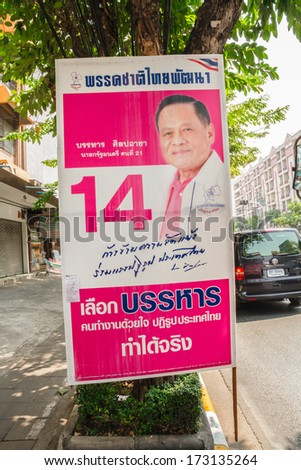 BANGKOK,THAILAND - JANUARY 26 : A roadside election campaign placard endorsing BaanHarn-ChartPattana Party Number 14, January 26, 2014 in Bangkok, Thailand. Thais go to the polls on 2nd Feb 2014