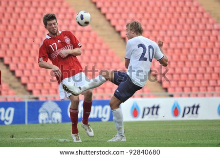 BANGKOK THAILAND - JANUARY 15 : A.Soderlund (R) in action during KING'S CUP 2012 between Denmark vs Norway on January 15, 2012 in Rajamangla Stadium,Bangkok, Thailand.