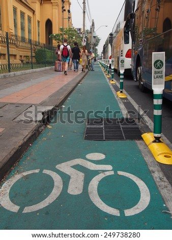 BANGKOK, THAILAND - JANUARY 31: Bike lane around Sanam Luang on January 31, 2015 in Bangkok, Thailand. Sanam Luang is an open field and public square in front of Wat Phra Kaew and the Grand Palace. - stock photo
