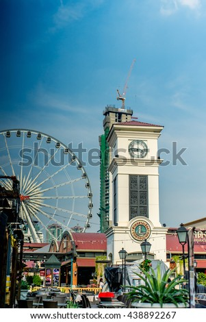 BANGKOK THAILAND - JANUARY 3 :Clock tower at evening time in Asiatique The riverfront , on  January 3, 2016 in Bangkok, Thailand.