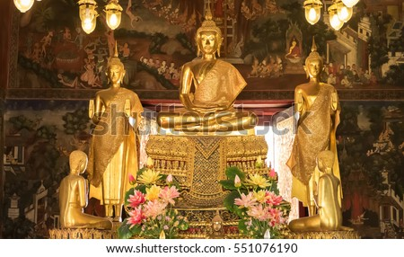 BANGKOK, THAILAND - JANUARY 2: Details of golden buddha statue with tales of the lord Buddha's former births behind at Wat Nairong on January 2, 2017 in Bangkok,Thailand.