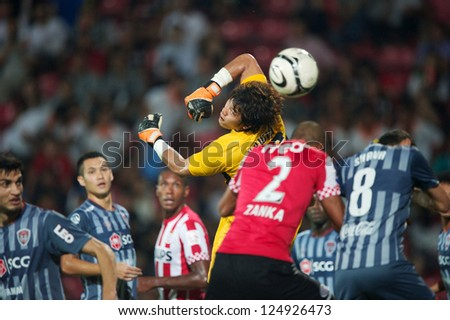 BANGKOK,THAILAND-JANUARY 8:Kawin Thamsatchanan (GK) of SCG Muangthong Utd. in action during The AIA Champions Cup match between SCG Muangthong Utd. and PSV at SCG Stadium on Jan8 ,2012 in ,Thailand.