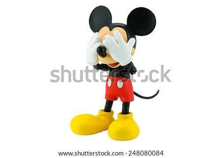 Bangkok, Thailand - January 5, 2015: Mickey Mouse action figure the official mascot of The Walt Disney Company. Mickey Mouse is a funny animal cartoon character was created by Walt Disney studio. - stock photo
