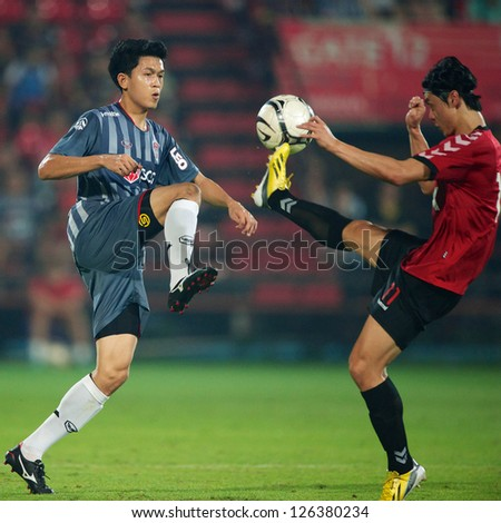 BANGKOK,THAILAND-JANUARY 22:	Piyaphon Bantao (L) of SCG Muangthong Utd.in action during The Friendly Match between SCG Muangthong Utd.and Gyeongnam FC at SCG Stadium on Jan 22, 2013 in,Thailand. - stock photo