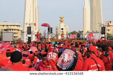 Bangkok, Thailand - January 23, 2011: Protesters take part in a large anti government Red Shirt rally at the landmark Democracy Monument.  - stock photo