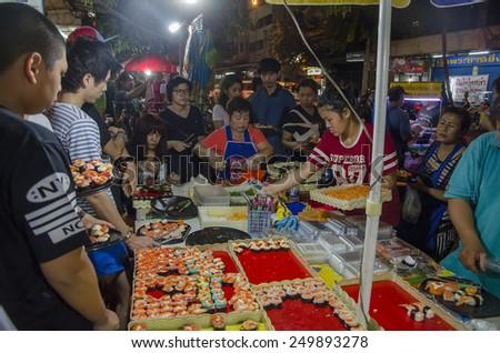 Bangkok, Thailand - 31 January 2015 : Sushi seller at bangkok chinatown on Yaowarat Road, Sushi is a one of favorite food for who come to travel at bangkok chinatown  - stock photo