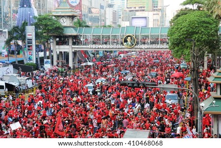 Bangkok, Thailand - January 9, 2011: Tens of thousands of anti government Red Shirt protesters defy an emergency decree to protest at Ratchaprasong Junction in the city centre. - stock photo
