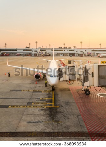 BANGKOK, THAILAND - JANUARY 26, 2016: Thai Lion Air Airplant dock at jet bridge waiting passengers at Don Mueang International Airport Terminal 2 re-opened on 24 December 2015 for domestic flights. - stock photo
