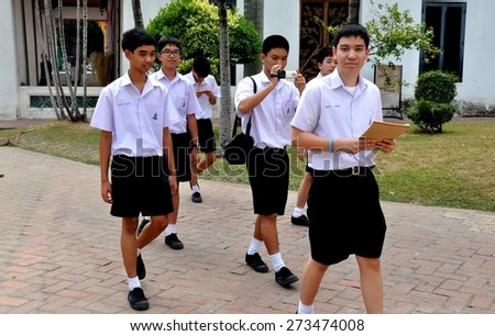 Bangkok, Thailand - January 19, 2011:  Thai teen-aged students in their regulation shorts and white shirts uniforms on a school trip to the National Museum - stock photo