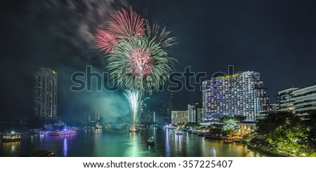 Bangkok, Thailand - 1 January 2016 : The fireworks celebrating year 2016 happening on the Chao Praya riverside which is one of the main landmark in Bangkok to celebrate this special occasion
