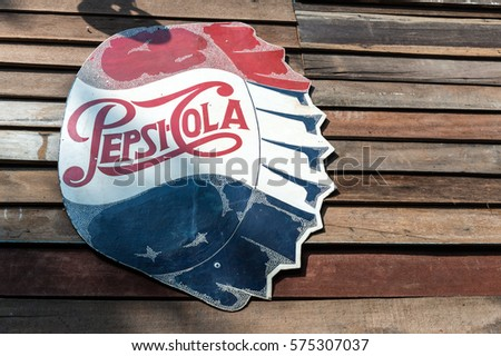 Bangkok, Thailand - January 30,2017 : The old rust condition vintage of Pepsi Cola sign on the wooden wall