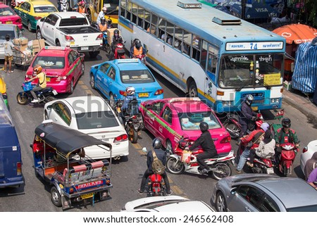 BANGKOK, THAILAND - JANUARY 22, 2015: Traffic moves slowly along a busy road in Bangkok, Thailand. Annually an estimated 150,000 new cars join the already heavily congested streets of Bangkok.