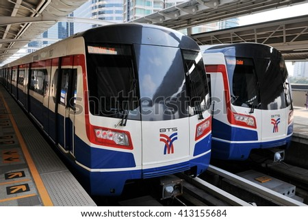 Bangkok, Thailand - January 13, 2011: Two BTS Skytrains wait at a city centre station. The rail network recently marked its 10th year of operations in the Thai capital.