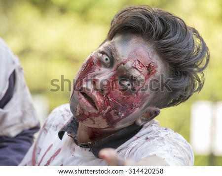 BANGKOK,THAILAND - JANUARY 8, 2015: Unknown Thai guy participates in FOX Thai The Walking Dead Season 5 Marathon, dressed as zombies