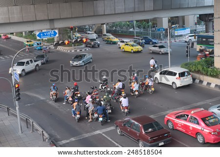 Bangkok, Thailand - January 30, 2015 :  Various vehicles break law by stop car beyond the white line on the ground during red light. This is typical behavior of people when traffic police is not strict - stock photo